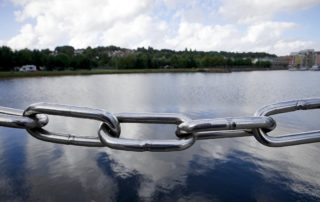 Chain link next to river