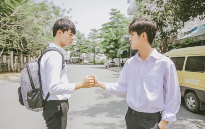 Two Asian men shaking hands